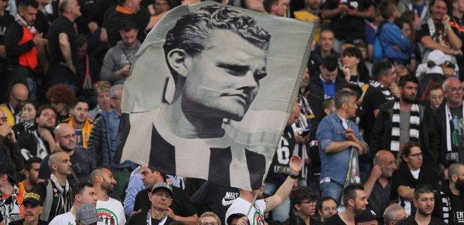 May 9, 2018 - Rome, Lazio, Italy - A Juventus fan waves a flag with the face of Juventus legend Giampiero Boniperti before the Italian Cup final match between Juventus FC and AC Milan at Stadio Olimpico on May 09, 2018 in Rome, Italy. .Juventus won 4-0 over Milan. Juventus v AC Milan - TIM Cup Final PUBLICATIONxINxGERxSUIxAUTxONLY - ZUMAn230 20180509_zaa_n230_1647 Copyright: xMassimilianoxFerrarox